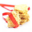 Cookies in the form of a house with red ribbon isolated on white — Stock Photo