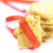 Cookies in the form of a house with red ribbon isolated on white - Stock Photo