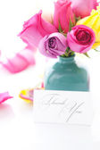 Bouquet of colorful roses in vase,petals and card with the words — Stock Photo