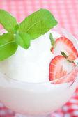 Ice cream,strawberry with mint in a glass bowl on plaid fabric — Zdjęcie stockowe