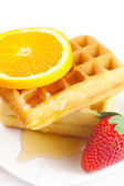 Belgian waffles,honey,orange and strawberries on a plate isolate — Stock Photo