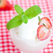 Ice cream with mint in a glass bowl and strawberry on plaid fabr — Stock Photo #30720021