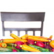 Heap of vegetables on a table and a chair isolated on white — Stock Photo