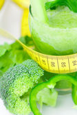 Measuring tape,broccoli,pepper,celery and glass with celery juic — Stock Photo