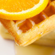 Belgian waffles,honey and orange on a plate isolated on white — Stock Photo