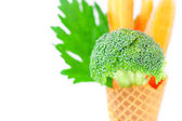 Carrot, celery, broccoli in a waffle cone isolated on white — Stock Photo
