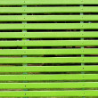 Gigantic green bench in the park — Stock Photo