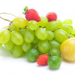 Bunch of white grapes,plum and strawberries isolated on white — Stock Photo