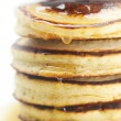 Stock Photo: Pancakes and honey isolated on white