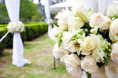 Wedding marquee with bouquets of roses — Stock Photo