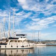 Sailing Boat docked in marina - Stock Photo