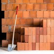 Masonry Shovel bucket and bricks - Stock Photo
