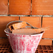 Masonry Bucket on hollow bricks - Stock Photo