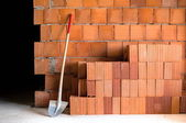 Masonry Shovel bucket and bricks — Stock Photo