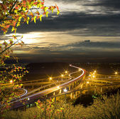 Highway in night with cars light — Стоковое фото