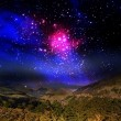 Stock Photo: Beautiful mountain and galaxy