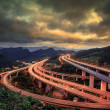 Red dramatic sunset over highway — Stok fotoğraf