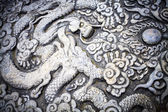 Closeup sculpture of dragon with wings — Stock Photo