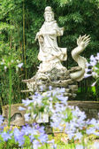 Sculptures of Chinese gods. (Kuan Yin) in the park. — Stock Photo