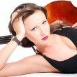 Stock Photo: Young womlying down in evening drerss by double bass
