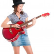 Screaming girl in black top hat playing guitar - Stock Photo