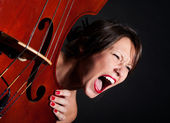 Girl face screaming by double bass — Stock Photo