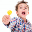 Little screaming excited boy with lollypop in hand — Stock Photo