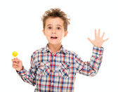 Little boy wave goodye with lollypop in hand — Stock Photo