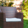 Stock Photo: Empty chair with pillow outdoors in sunny summer garden