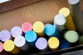 Multicoloured chalks in the box — Stock Photo