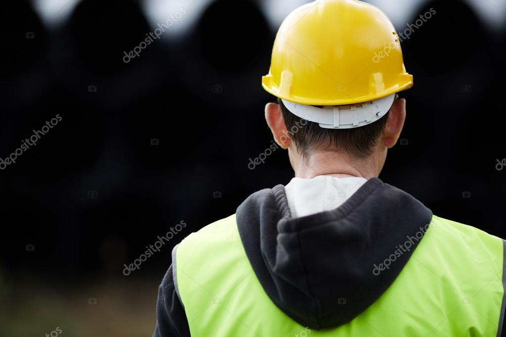 Builder with yellow hard hat, selective focus — Stock Photo #12884453