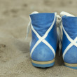 Foot-gear on the beach — Stock Photo