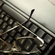 Stock Photo: Black keyboard and glasses