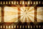Warm vintage film background with dark border and rays — Stock Photo