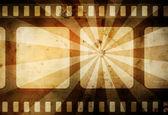 Fondo cálido película vintage con borde oscuro y rayos — Foto de Stock