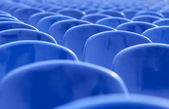 Empty blue chairs — Stock Photo
