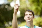 Teen with palmtop — Stock Photo