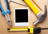 Builder tools and vintage photo paper — Stock Photo