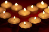 Holiday candles background — Stock Photo