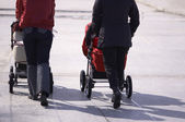 Walk with baby carriage — Stock Photo