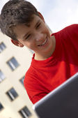 Teen playing on laptop — Stock Photo