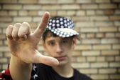 American teen(special fx with vignetting,focus on the hand) — Stock Photo