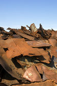Scrap metal(focus point on the nearest items) — Stock Photo