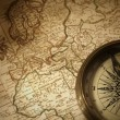 Vintage compass on a map — Stock Photo