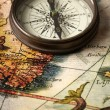 Stock Photo: Vintage compass on a map