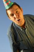 Man in grappige glb — Stockfoto