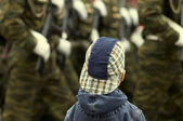 Boy and military on the parade — Stock Photo