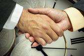 Handshake behind a money and clock background.Great for any des — Stock Photo