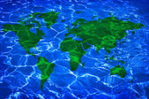 Blue water and green worlwide map — Stock Photo