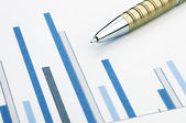 Pen and charts — Stock Photo